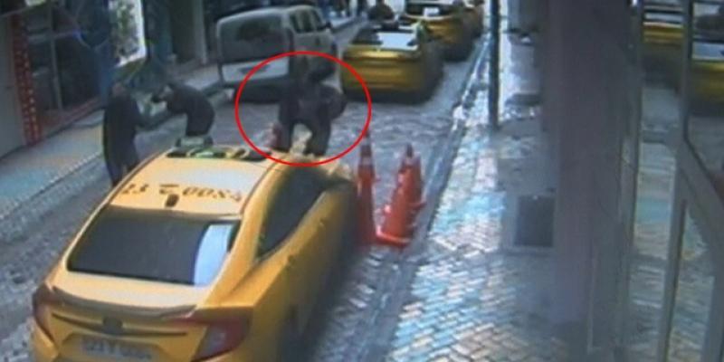2. kattan taksinin üzerine düştü, o anlar kamerada